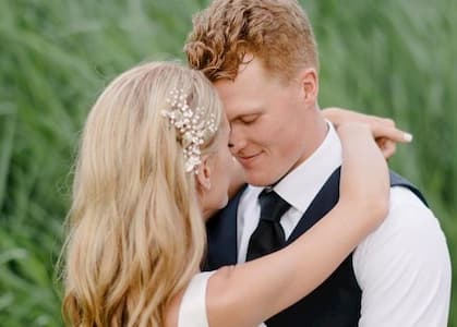 Emily and her husband Colby on their wedding day